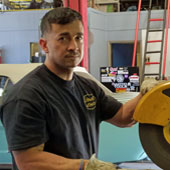 Jason Hernandez working in the shop