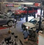 Shop floor with vehicles being repaired
