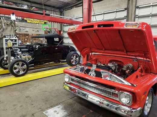 Classic cars inside Exhaust Authority shop